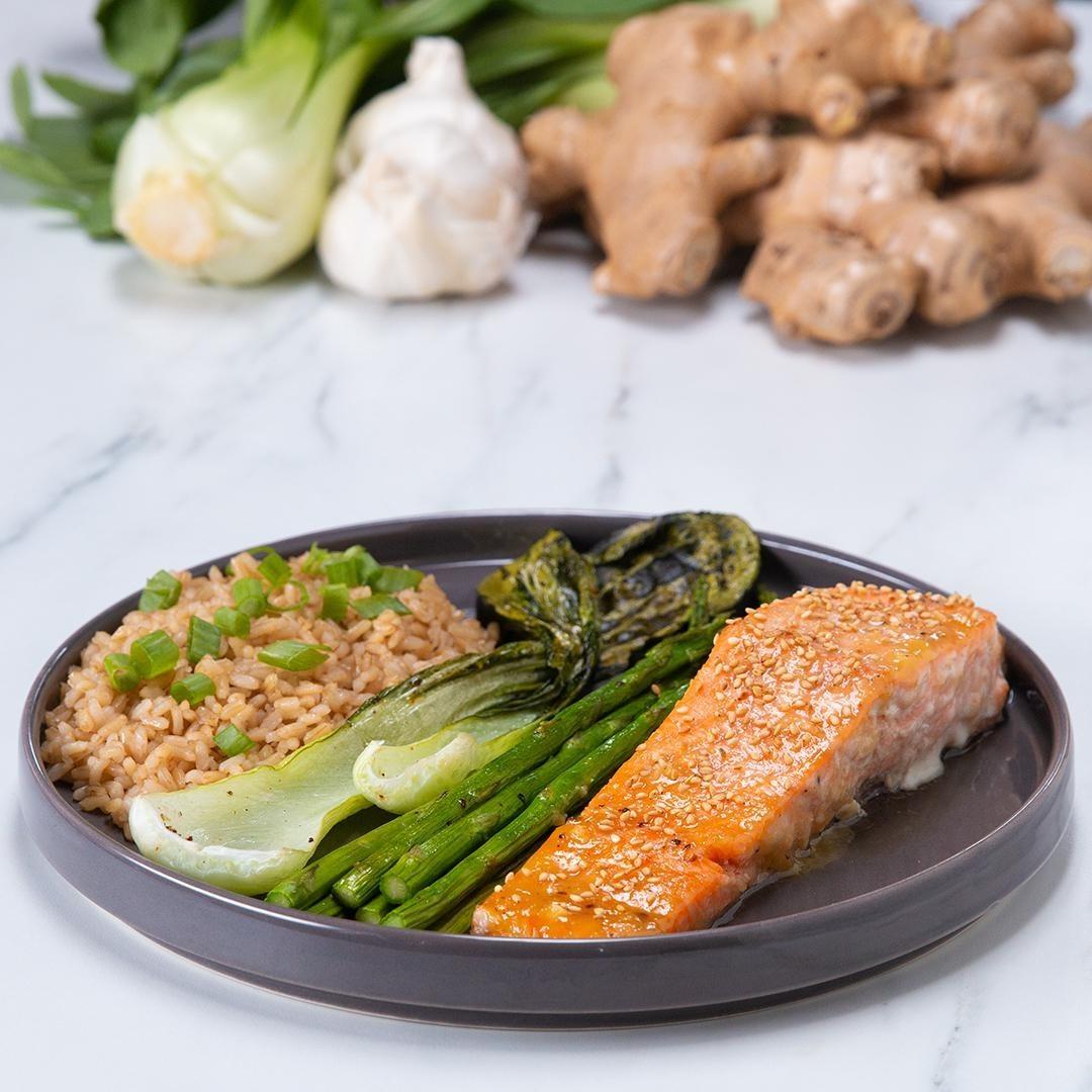 Plate of salmon, rice, and veggies