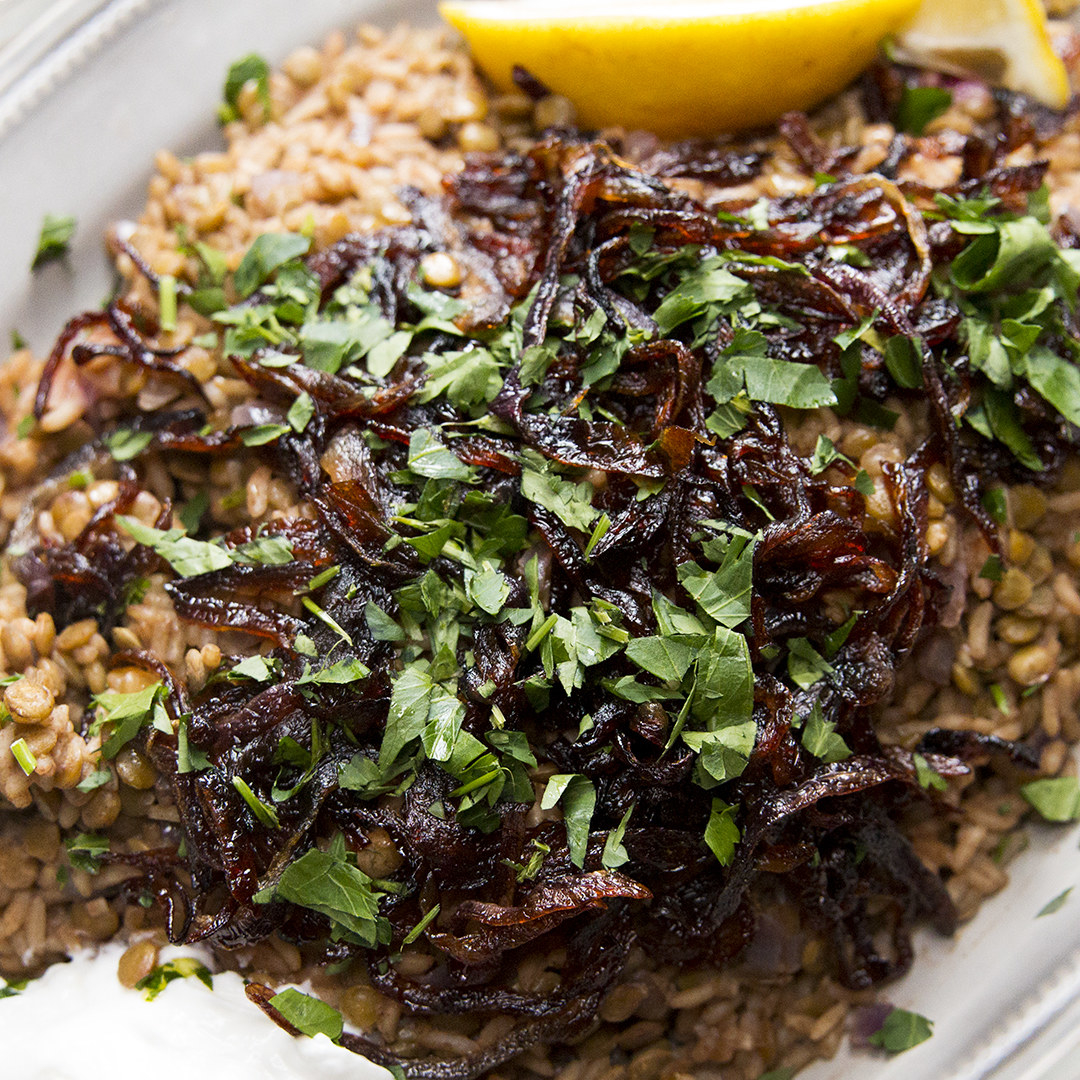Pile of rice and lentils topped with herbs
