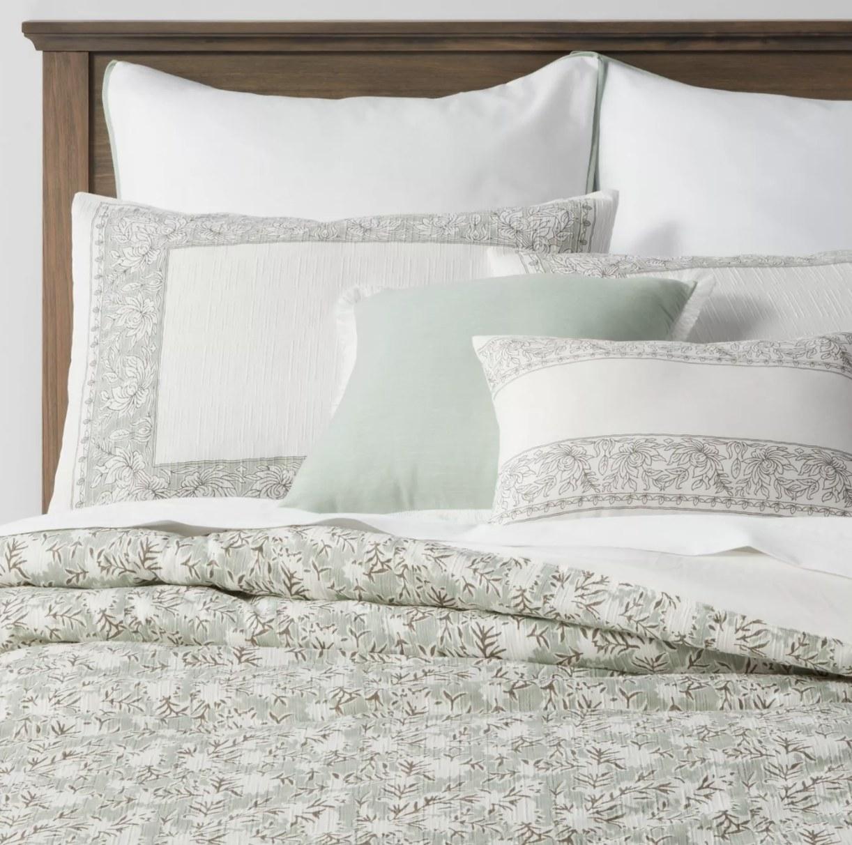Floral comforter on bed