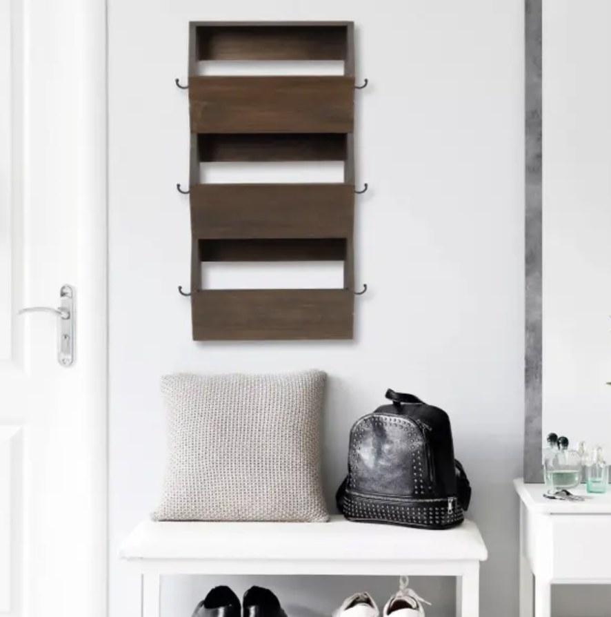 Hanging bins mounted to hallway wall