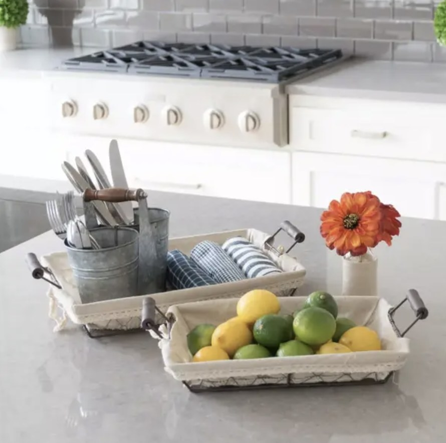 Wire baskets holding various items on kitchen counter