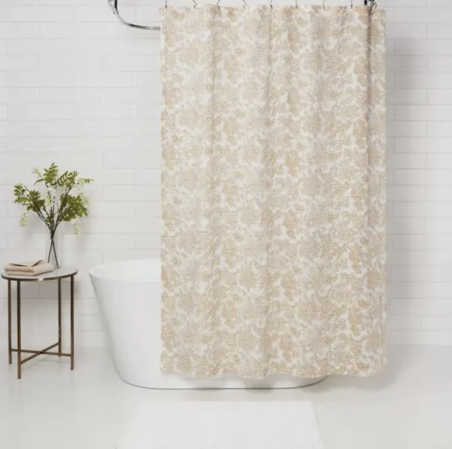 Floral flower curtain hanging from shower rod