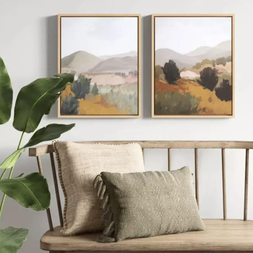 Framed canvases over decorative bench