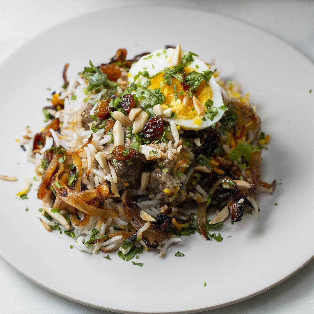 Rice and lamb topped with egg and nuts