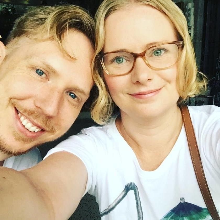 Erin posing in glasses with her husband