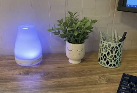 the diffuser lit up blue in a reviewer's office