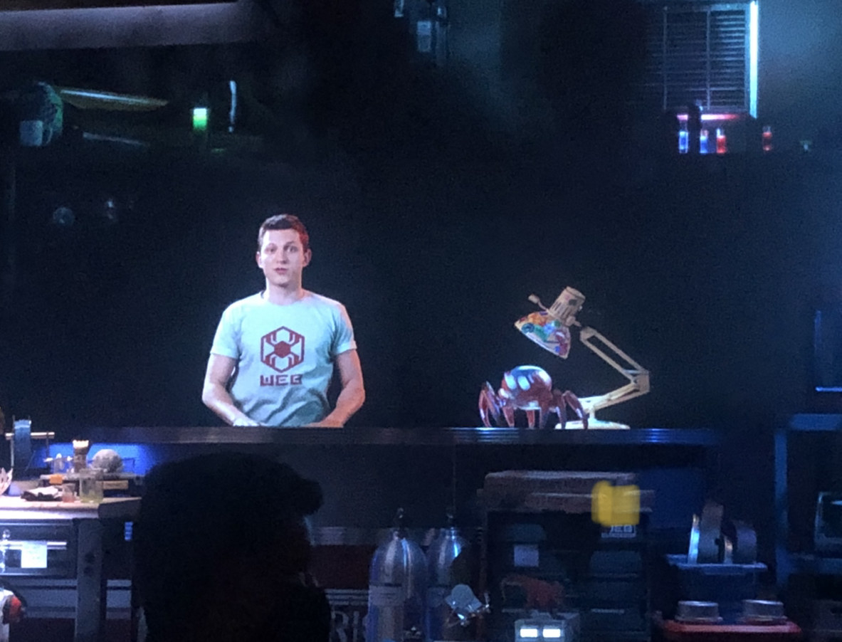 A hologram of Tom Holland and a spider-bot