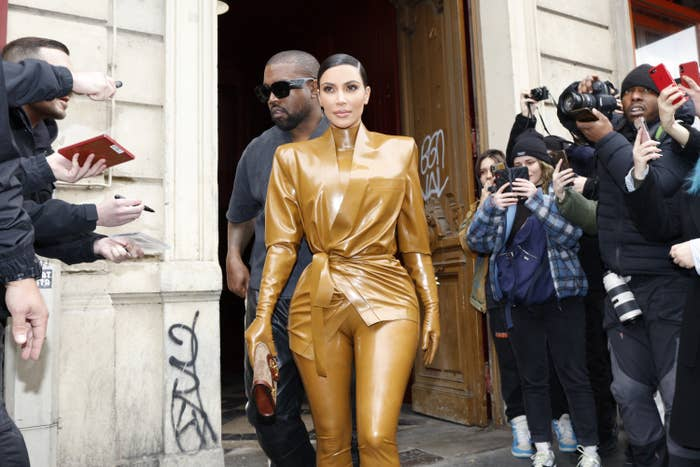Kim Kardashian and Kanye West step outside the Sunday Service event in Paris in March 2020