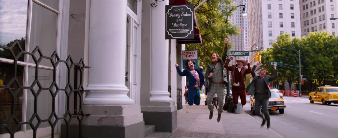 """Brian Fantana, Ron Burgundy, Champ Kind, and Brick Tamland jumping happily on the sidewalk in """"Anchorman 2 The Legend Continues"""""""