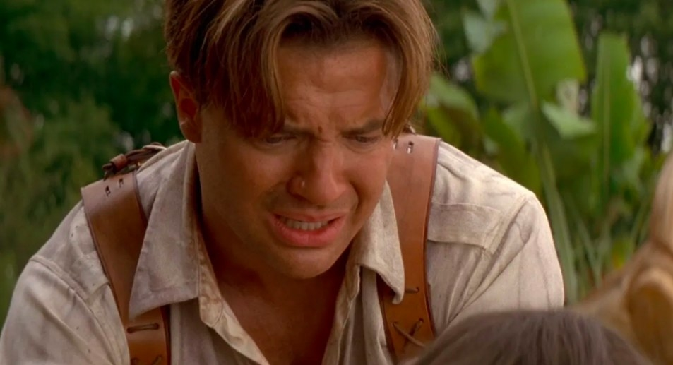 Rick cries while looking at Evie lying below him
