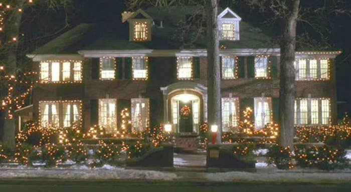 The house from Home Alone, a two story mansion, decorated for Christmas