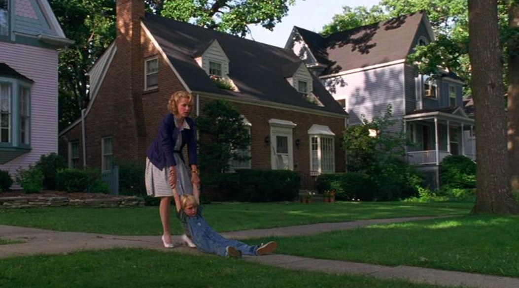 The neighborhood from Dennis the Menace with Dennis and his. mother in the foreground