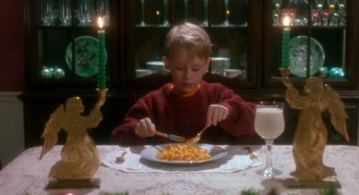 Kevin sits at the dinner table with food and a glass of milk