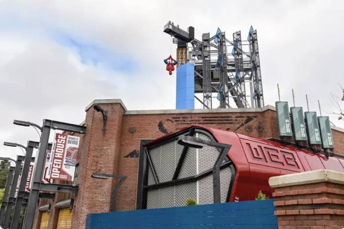 Spider-Man hangs atop the outside of the new Spider-Man ride