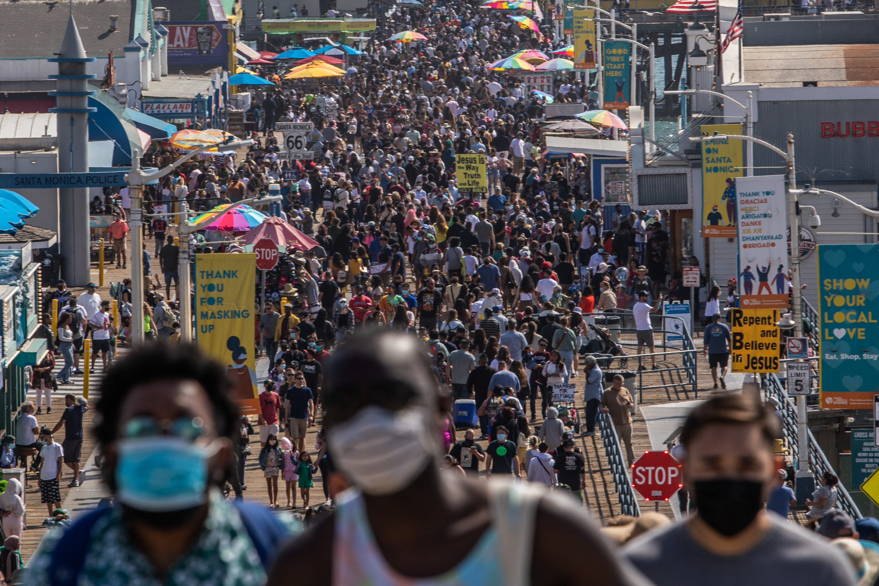 People walk through the Santa Monica pier ahead of Memorial Day in California on May 29, 2021