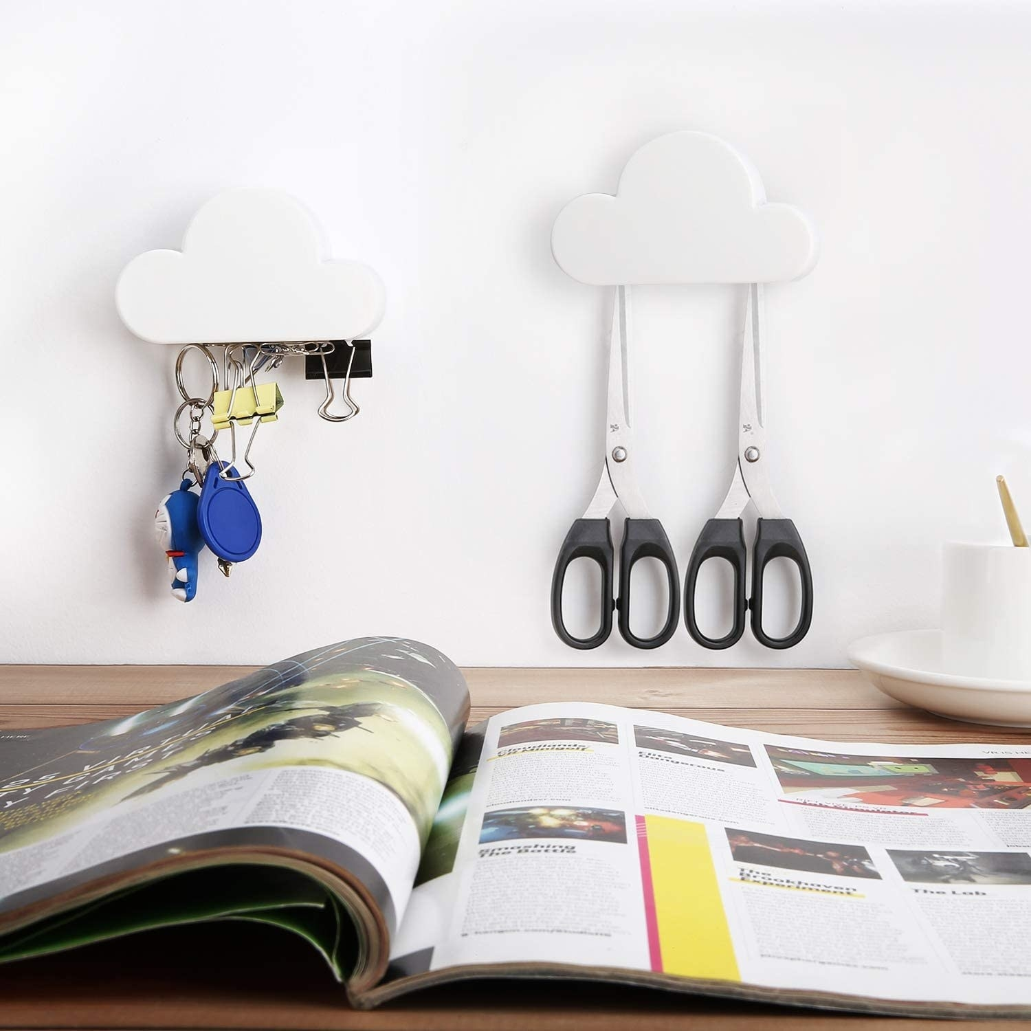 Two clouds holding paperclips and scissors