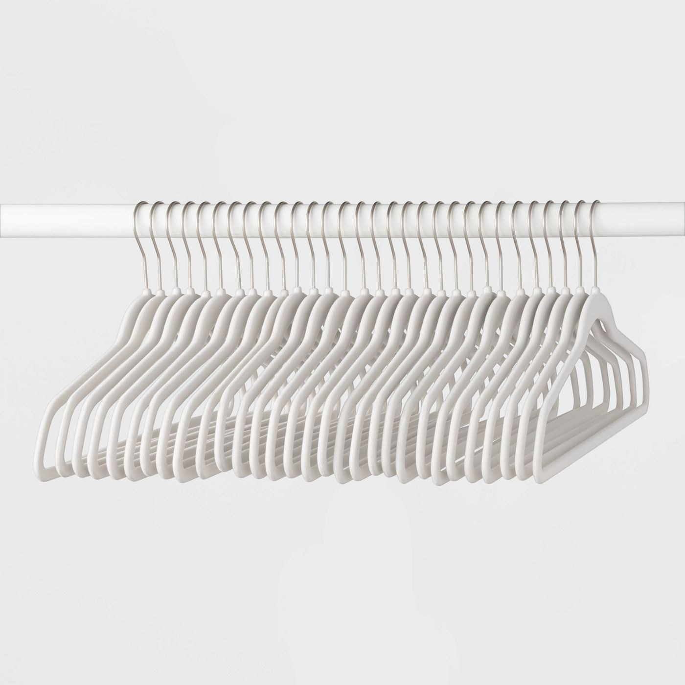 A set of white suit hangers hanging