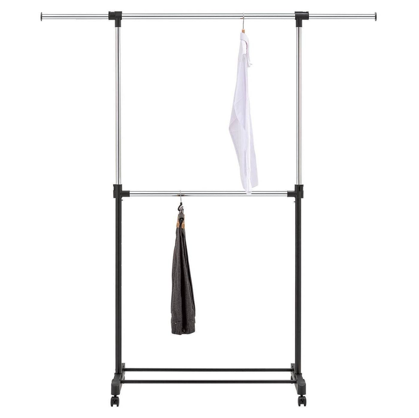 A double garment rack with black and white clothes
