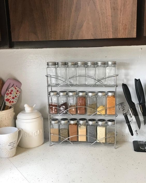 the jars with different spices on a spice rack