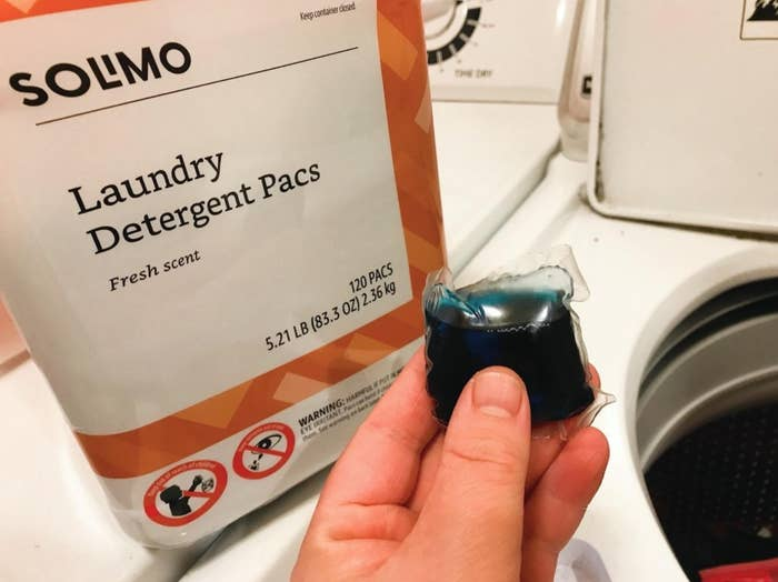 reviewer photo of the laundry pods on top of their washing machine