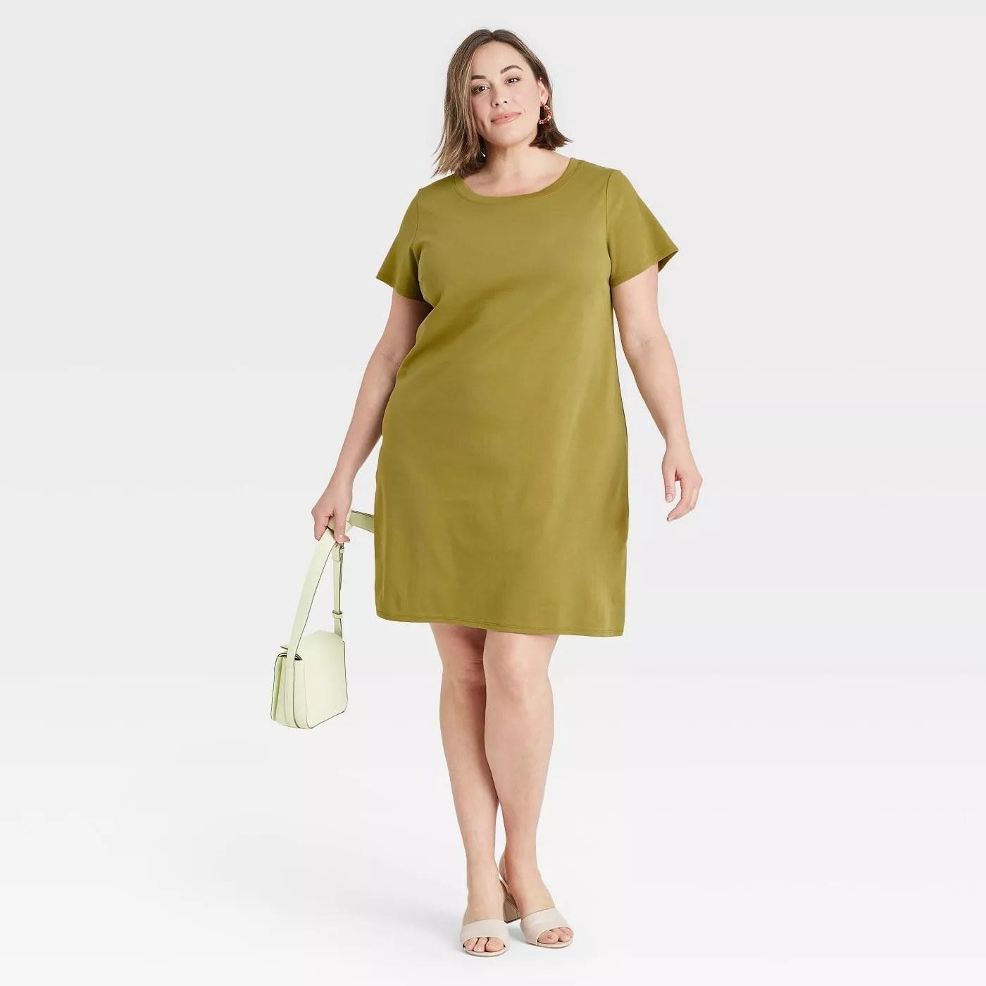 A model wearing the T-shirt dress in green