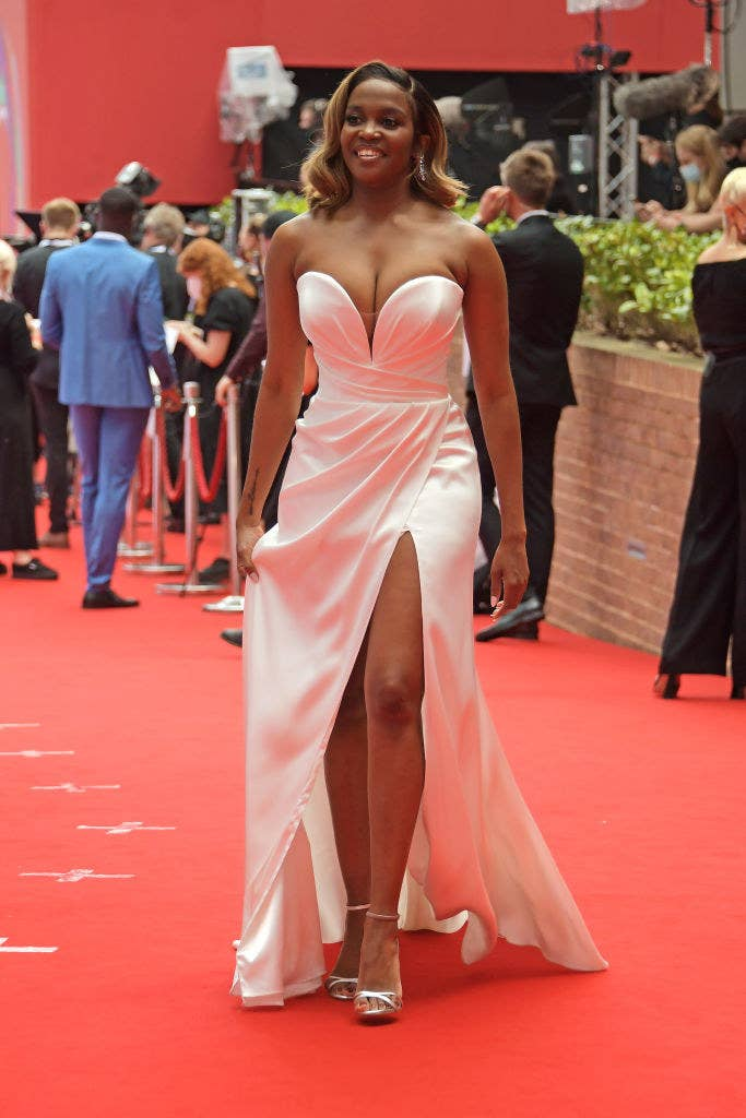 Oti Mabuse arrives at the Virgin Media British Academy Television Awards 2021 in a strapless sweetheart gown