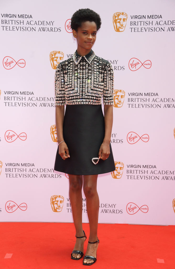 Letitia Wright arrives at the Virgin Media British Academy Television Awards 2021 in a bejeweled short dress and heels