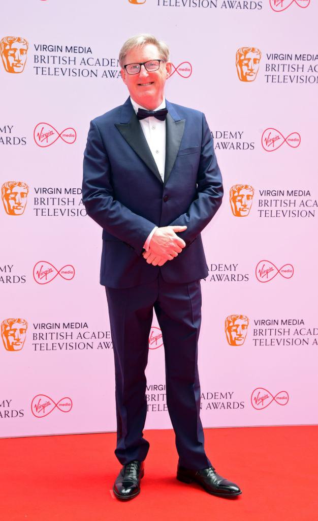 Adrian Dunbar arrives for the Virgin Media BAFTA TV awards in a suit