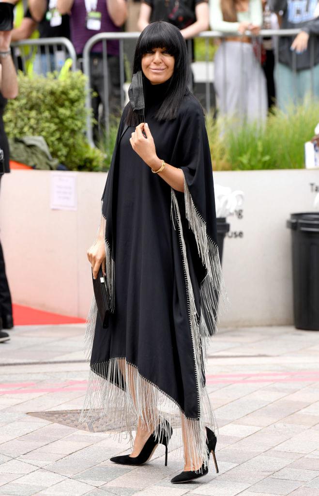 Claudia Winkleman arrives for the Virgin Media Bafta TV Awards in a fringe dress and Louboutin heels