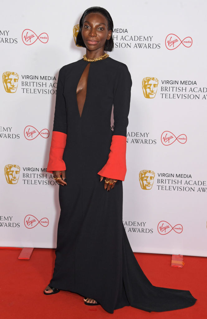 Michaela Coel at the Virgin Media British Academy Television Awards 2021 with slicked back hair and rocking a two-toned gown