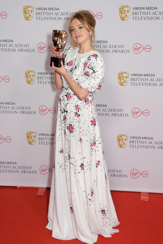 """Aimee Lou Wood, winner of the Best Female Comedy Performance award for her role in """"Sex Education"""", poses in the Winners Room at the Virgin Media British Academy Television Awards 2021"""