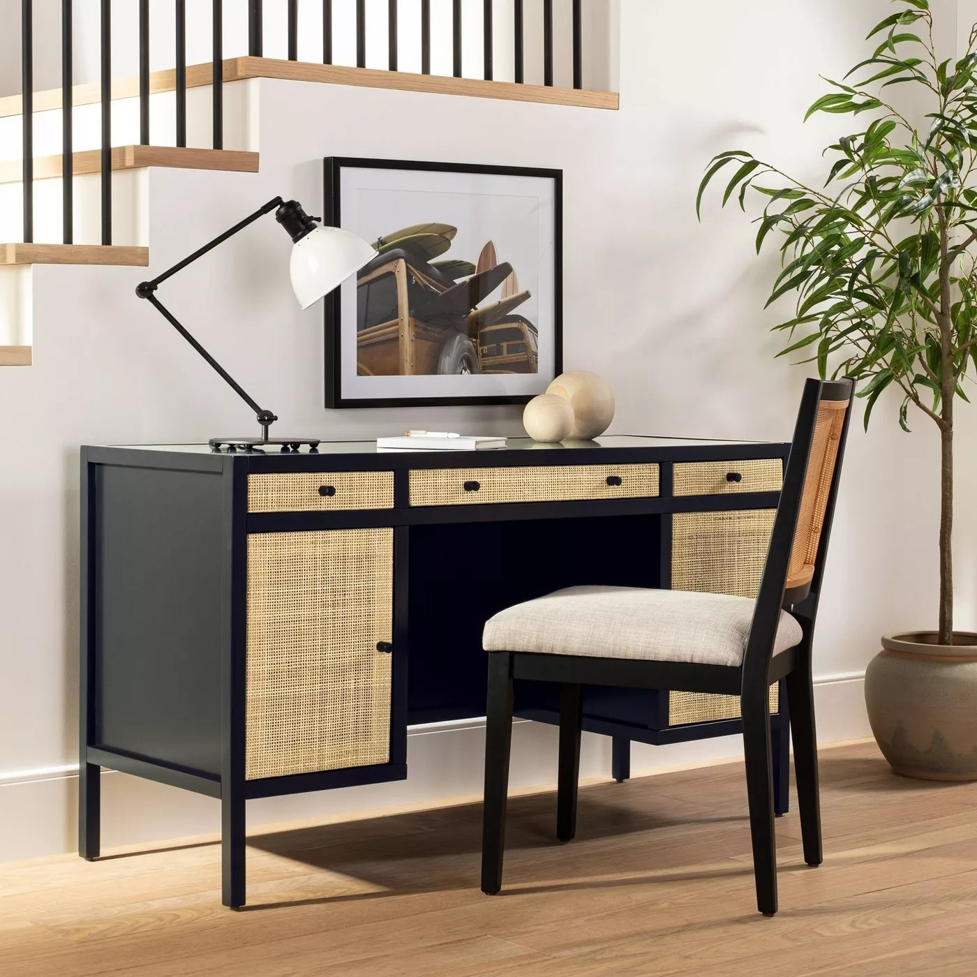 The black desk with woven front panels