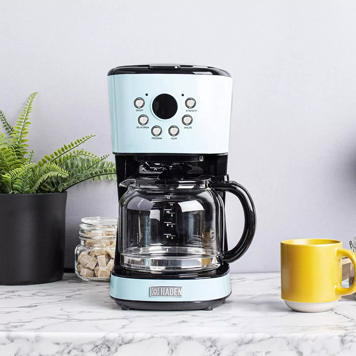 The turquoise coffee maker and a glass carafe