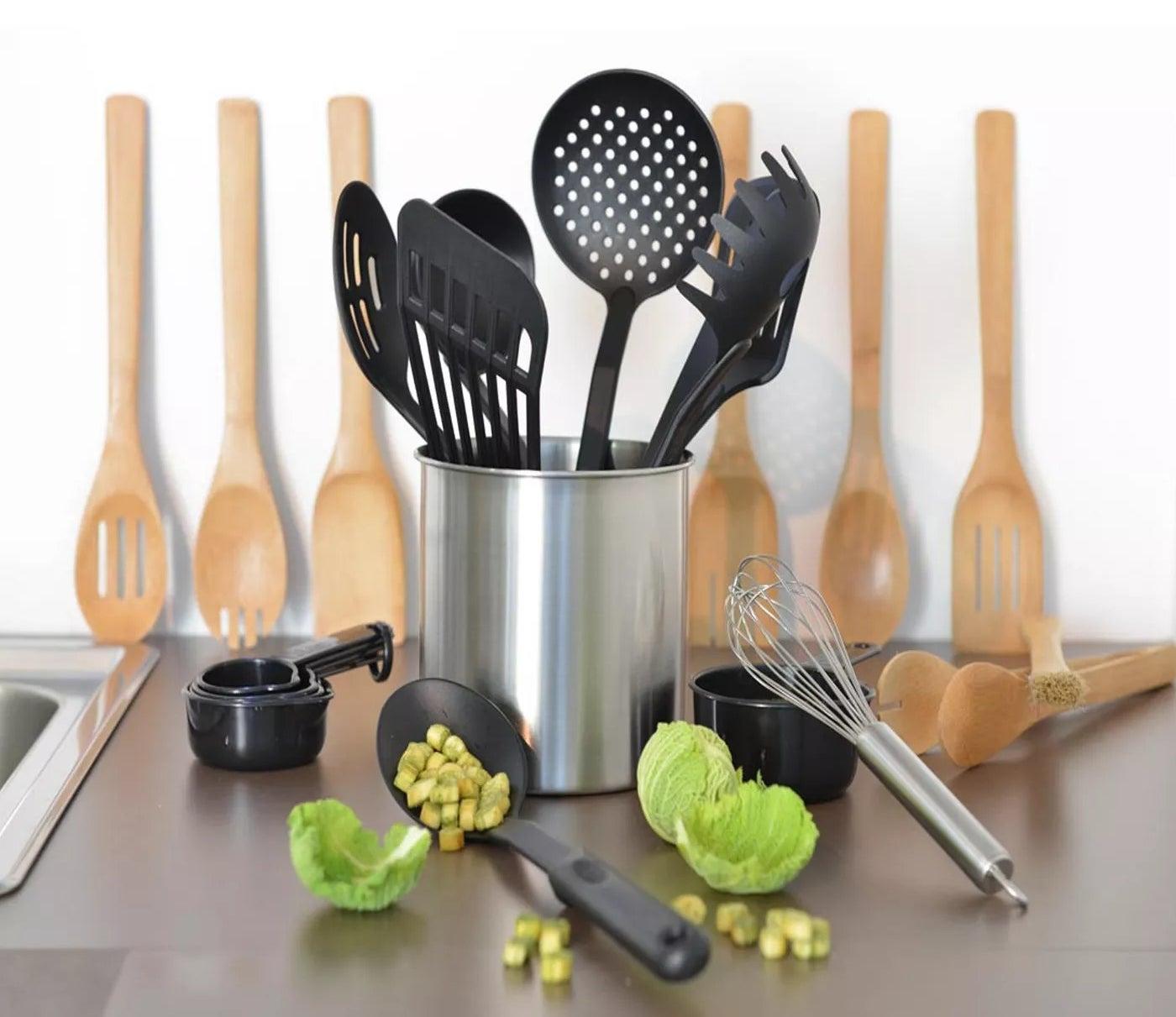 The stainless steel kitchen utensil holder with black nylon and bamboo utensils