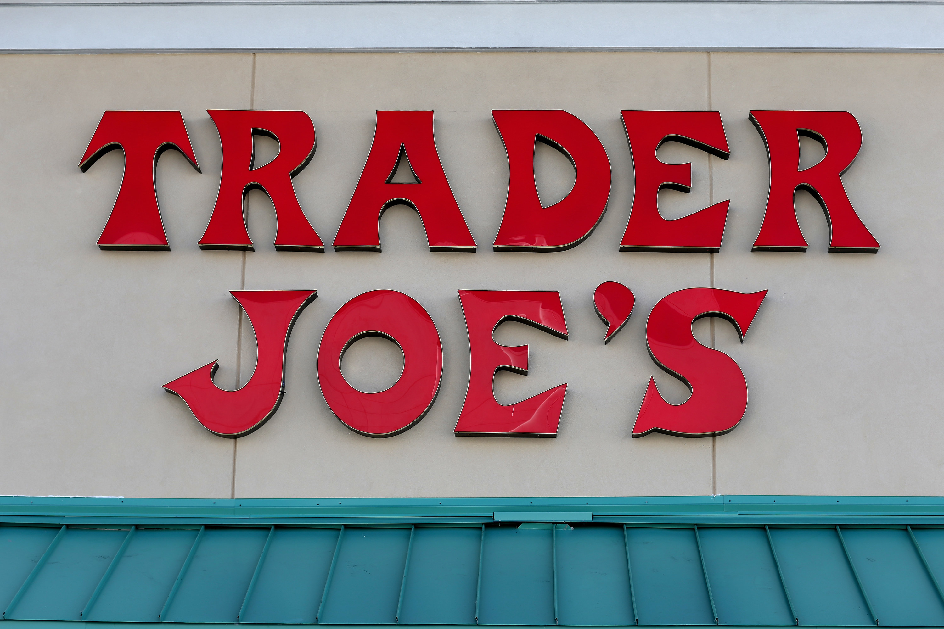 Red Trader Joe's sign in front of store.