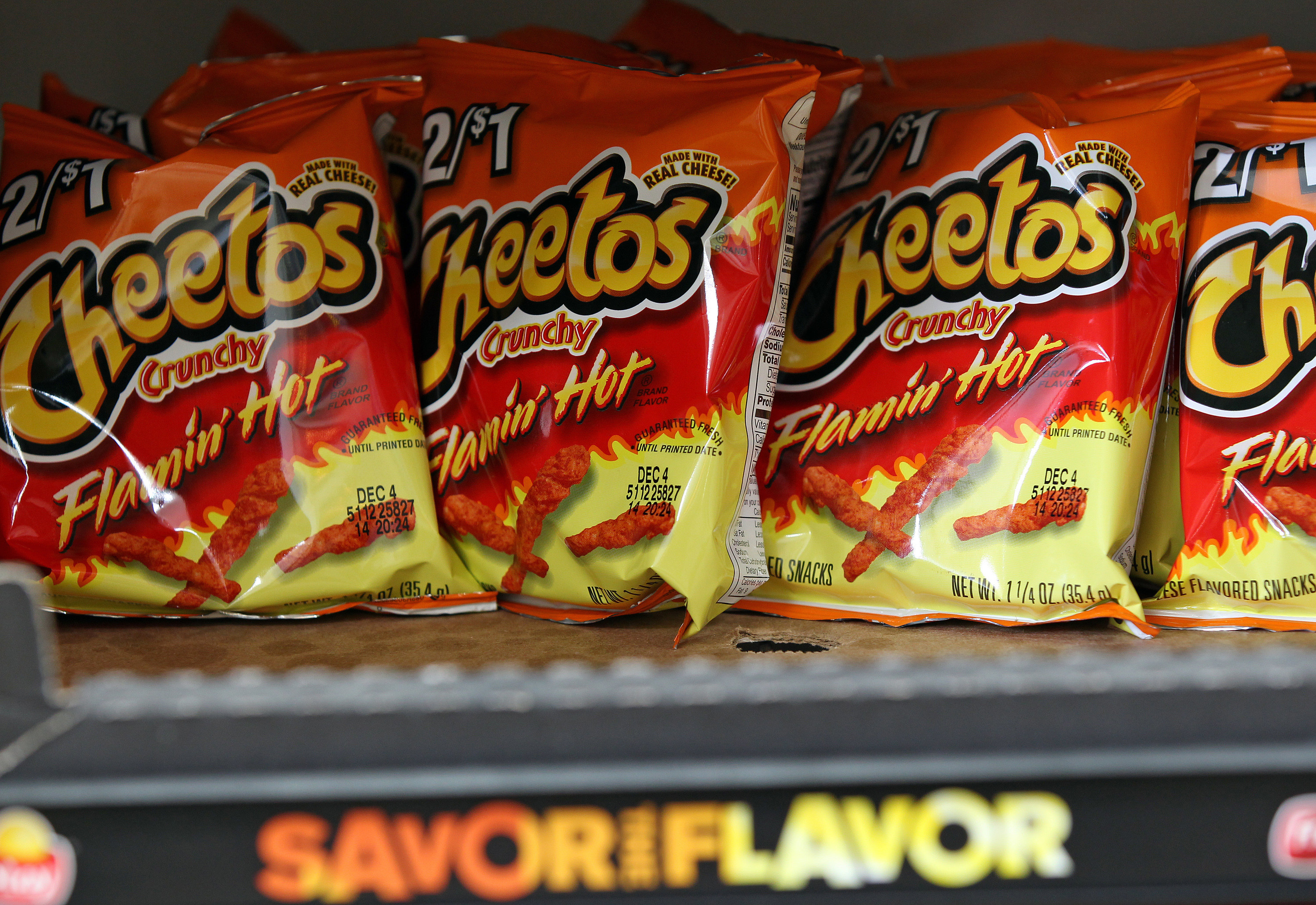 Shelf stocked with Hot Cheetos bags