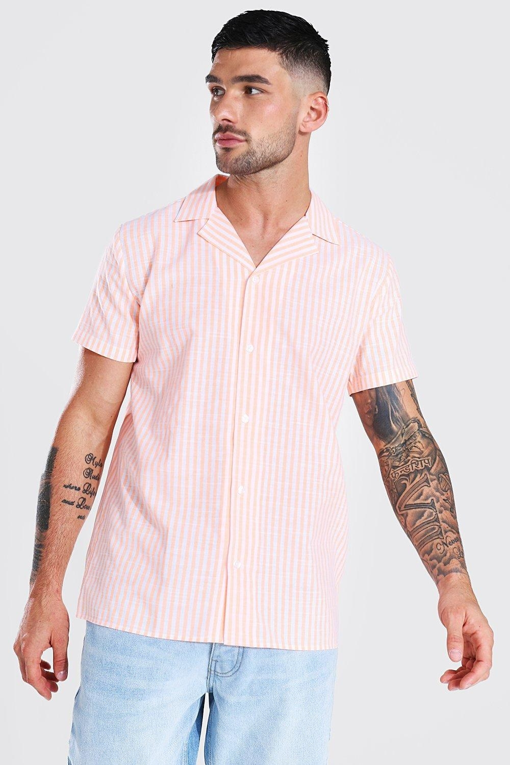 a model in a pink and white striped button down