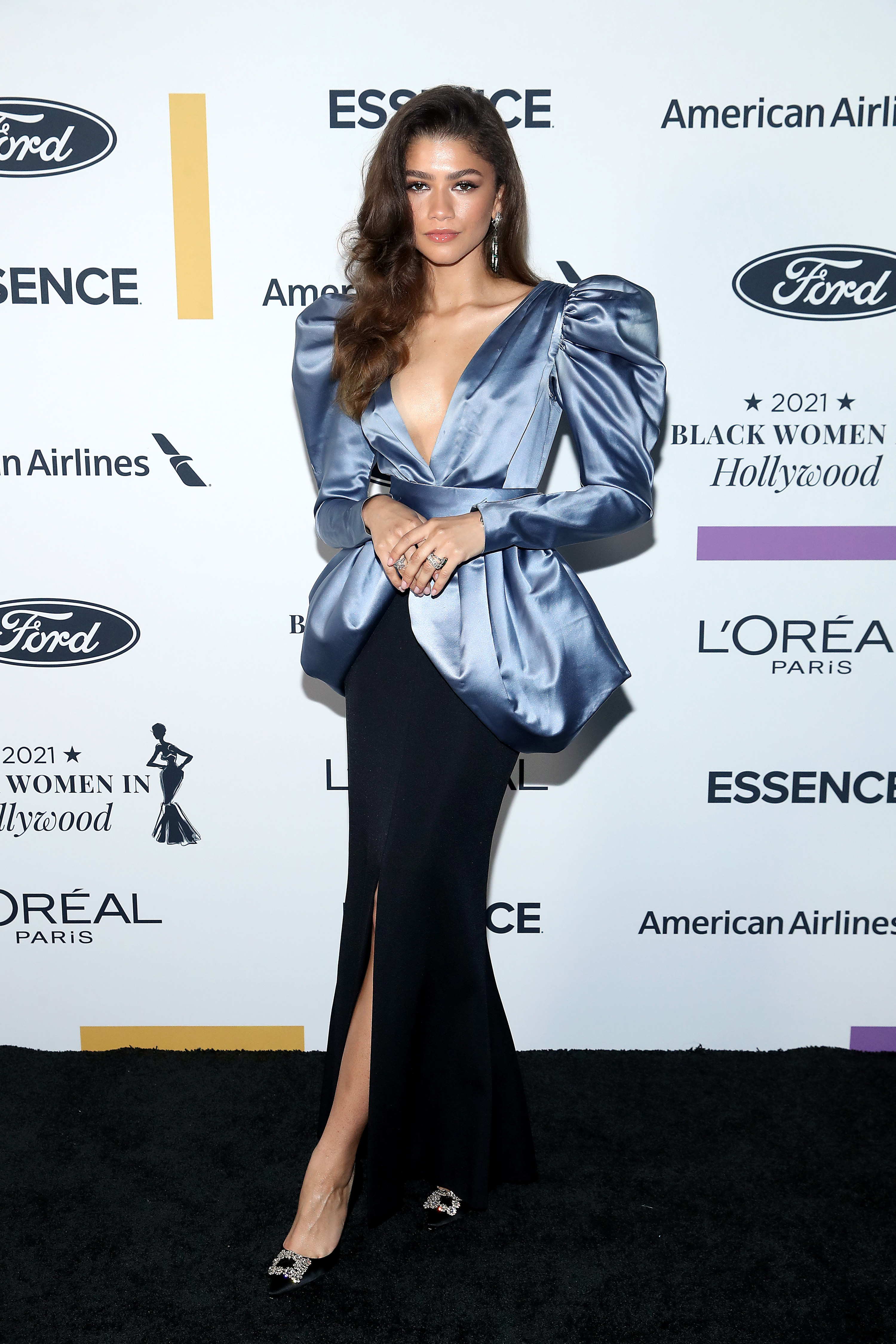 Zendaya arrives and poses on the black carpet for the 2021 ESSENCE Black Women in Hollywood Awards in Los Angeles, California