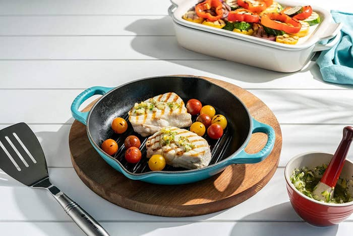 The pan in blue with fish in it