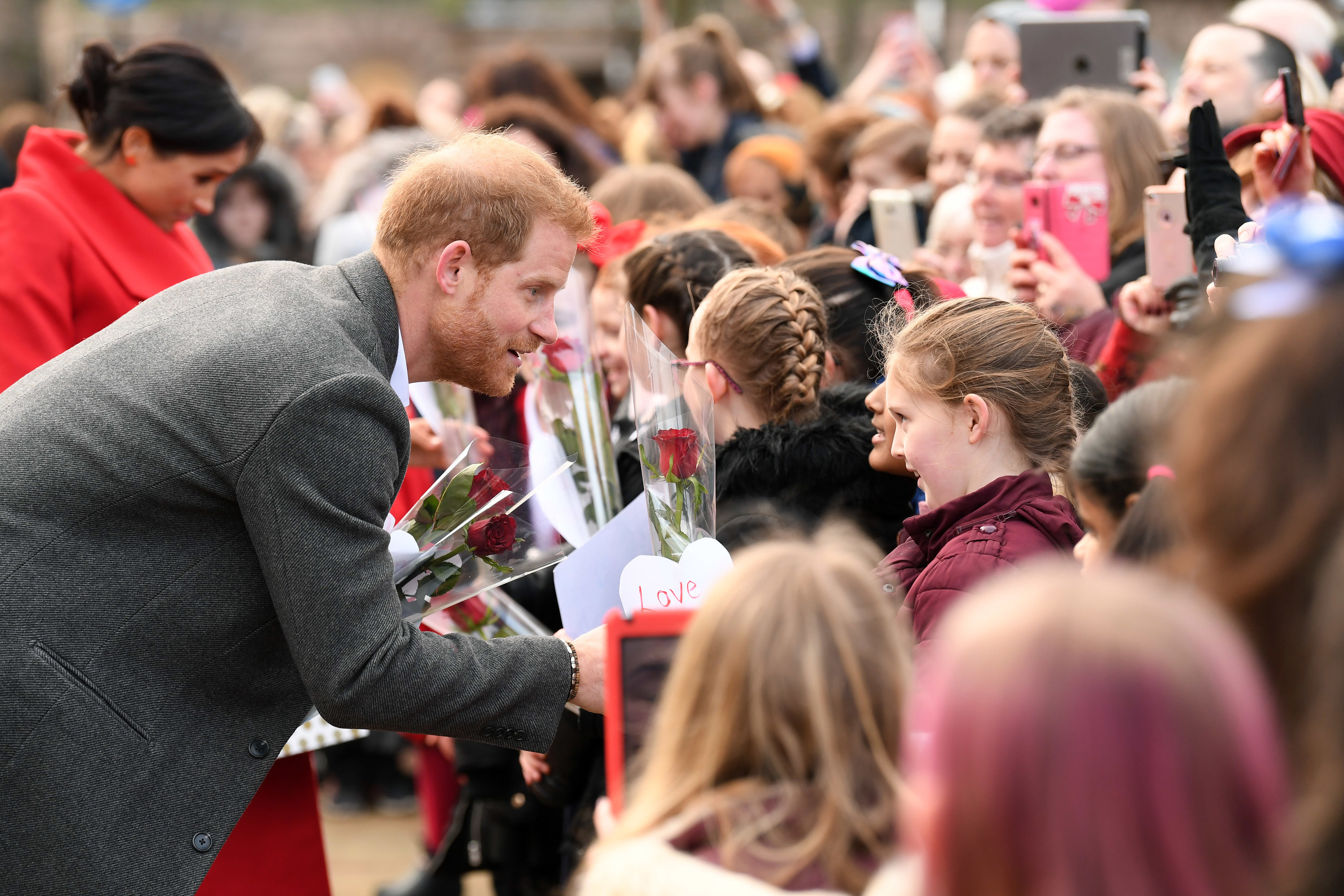 Prince Harry, Duke of Sussex meets members of the public during a visit of Birkenhead at Hamilton Square on January 14, 2019 in Birkenhead, UK