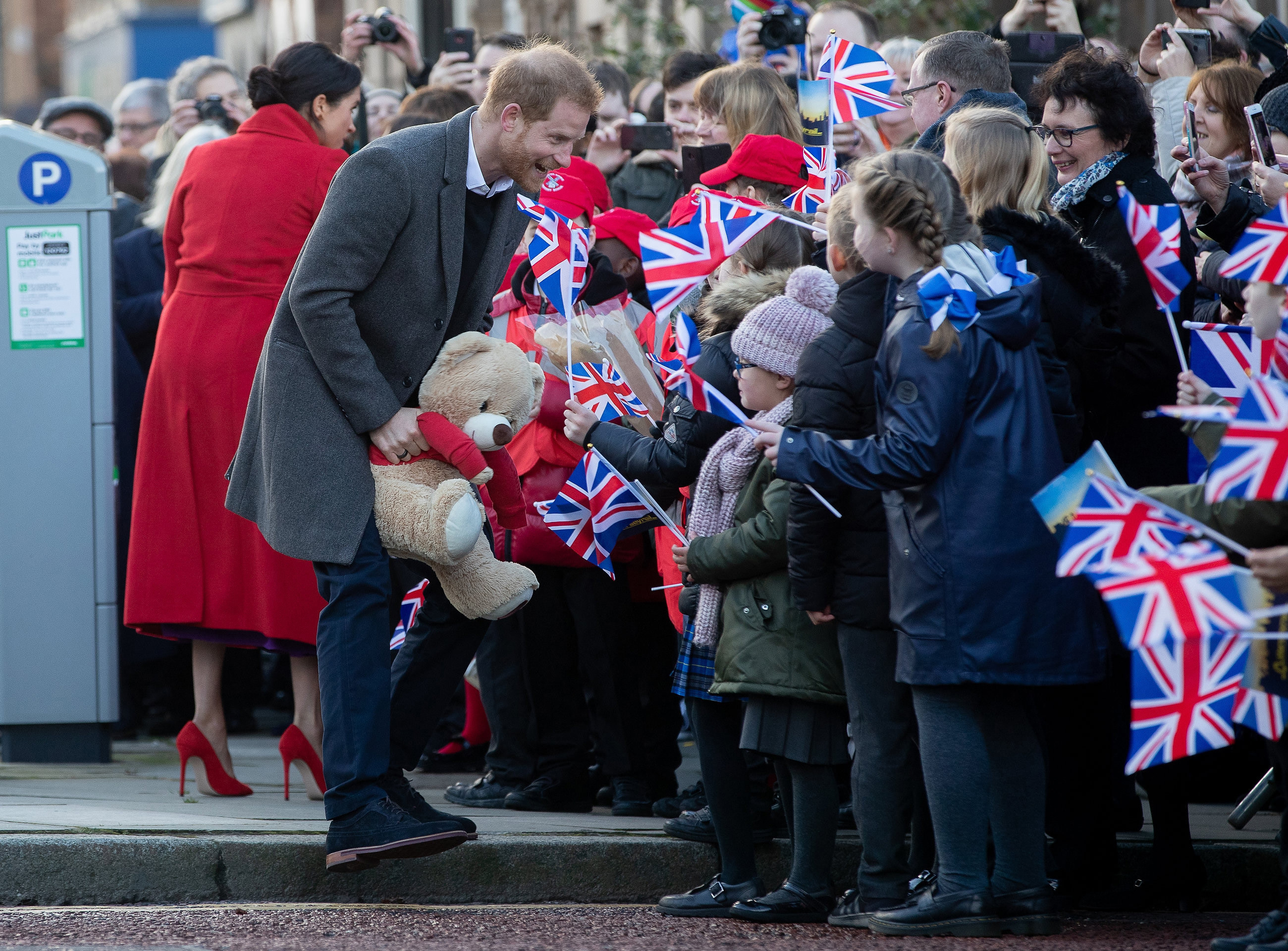 Prince Harry, Duke of Sussex and Meghan, Duchess of Sussex greet well-wishers on Hamilton Square during an official visit to Birkenhead on January 14, 2019 in Birkenhead, United Kingdom