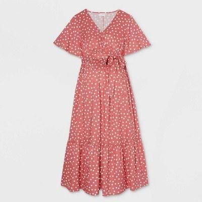 a pink polka dot wrap dress