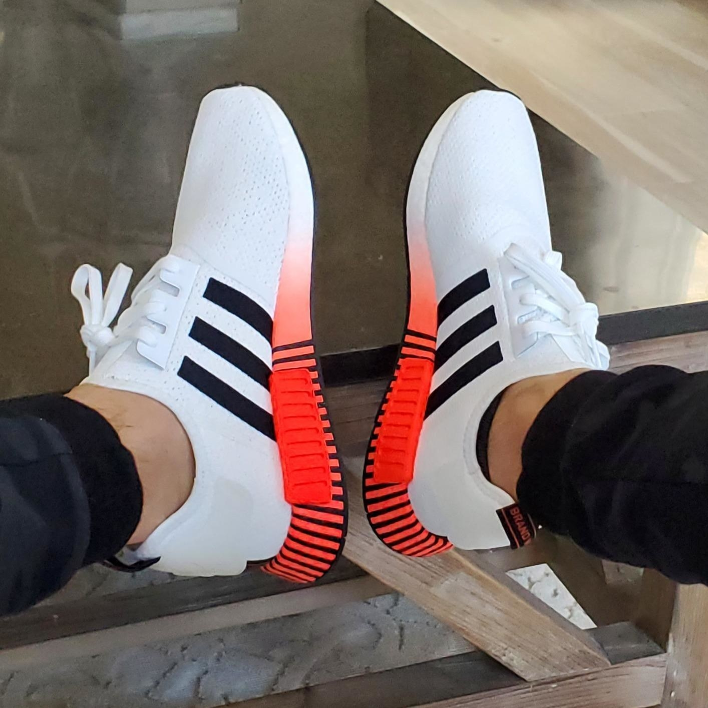 The shoes in white and orange
