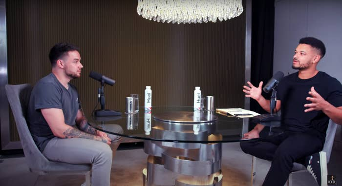 Liam Payne and Steven Barlett sit at a table on set of The Diary of a CEO podcast
