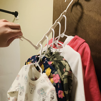 A reviewer's clothes on the hanger in its compressed condition