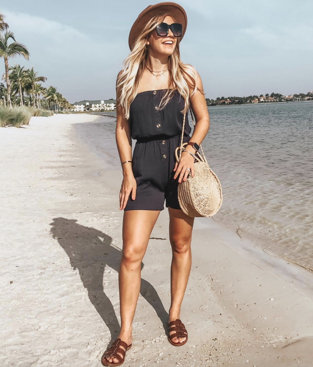 reviewer wearing black romper with buttons