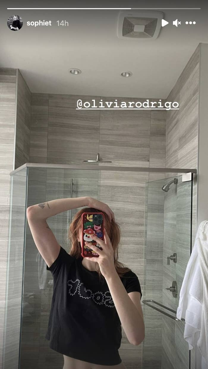 Sophie Turner showing her new hair red off