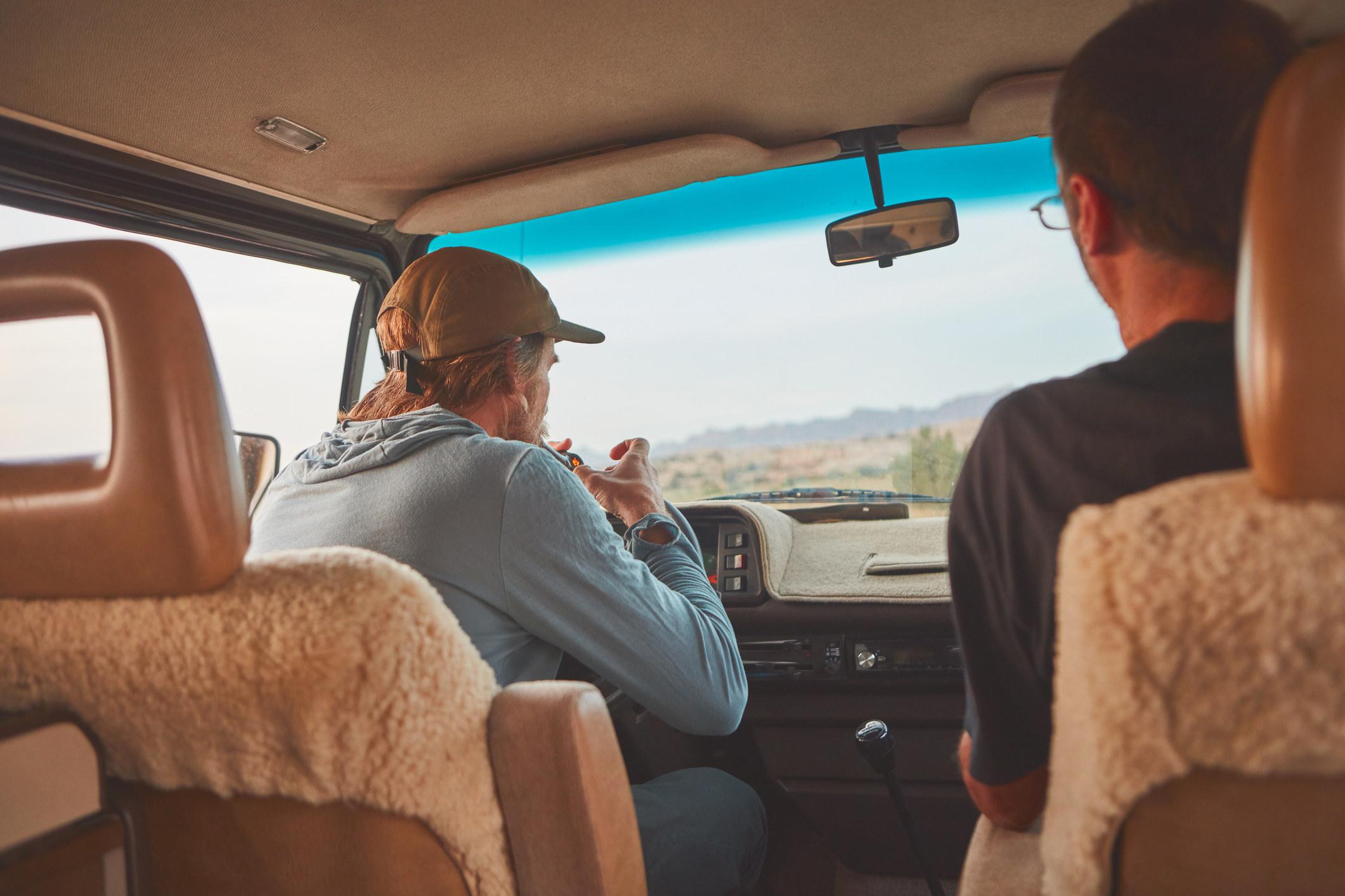 man smoking with friend in a van