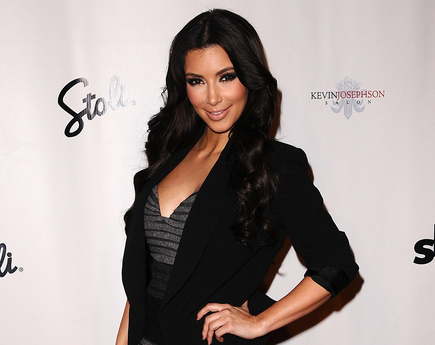 Kim poses with her hand on her hip at an old event
