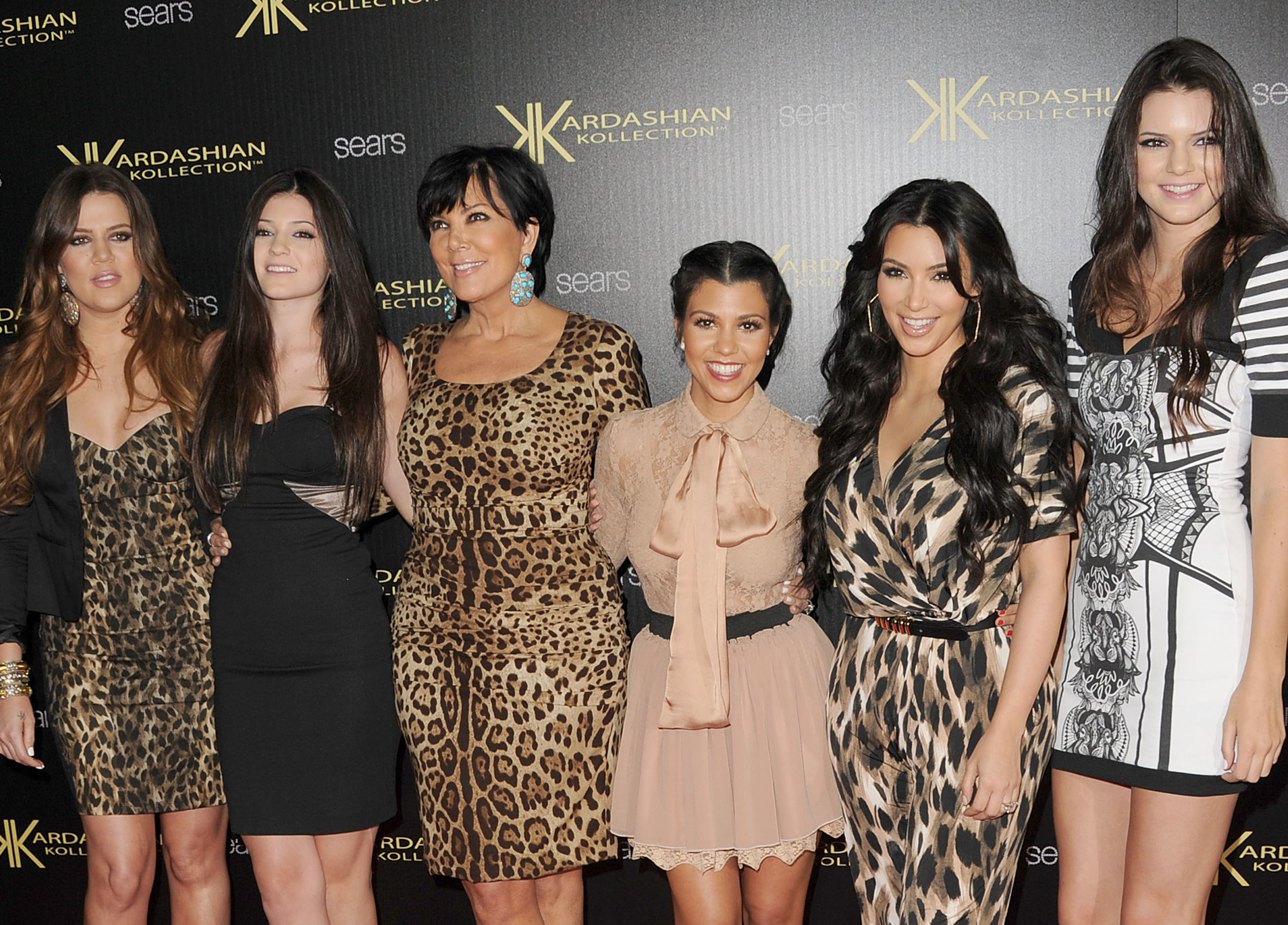 All the Kardashian women at an event wearing animal-print dresses